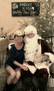 GreenMarket Manager Lori Nolan posing with Santa last year